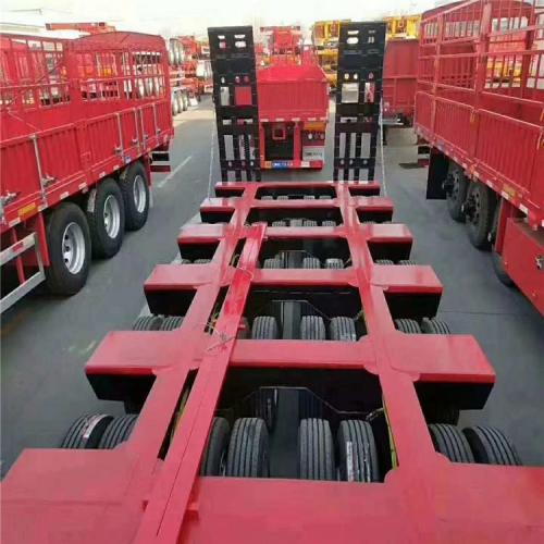 工程机械运输车 8线十六桥液压爬梯低平板半挂车生产厂家
